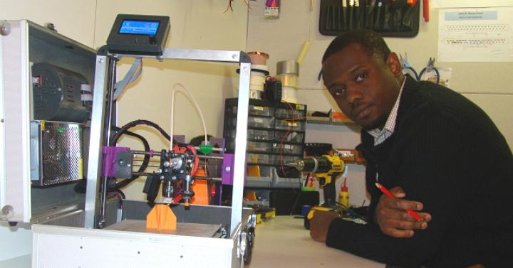 Emmanuel Adetutu with his TeeBot 3D Printer in a suitcase.