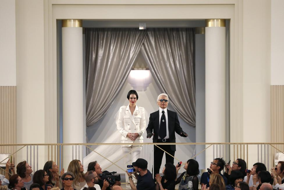 German designer Karl Lagerfeld appears with model Kendall Jenner at the end of his Haute Couture Fall Winter 2015/2016 fashion show for Chanel at the Grand Palais in Paris, France, July 7, 2015. REUTERS/Stephane Mahe