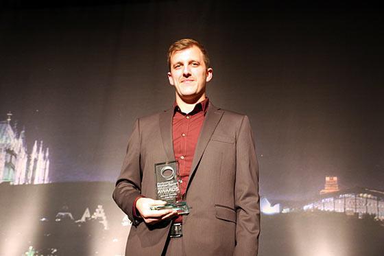 Stratasys Senior Application Engineer Amos Breyfogle accepts the award on behalf of Stratasys