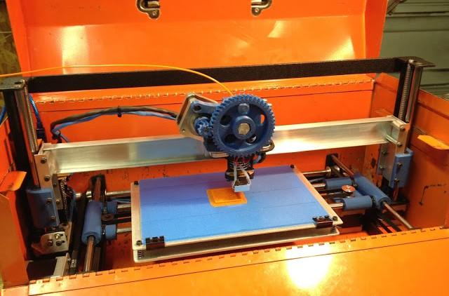 The completed toolbox 3D printer in action.