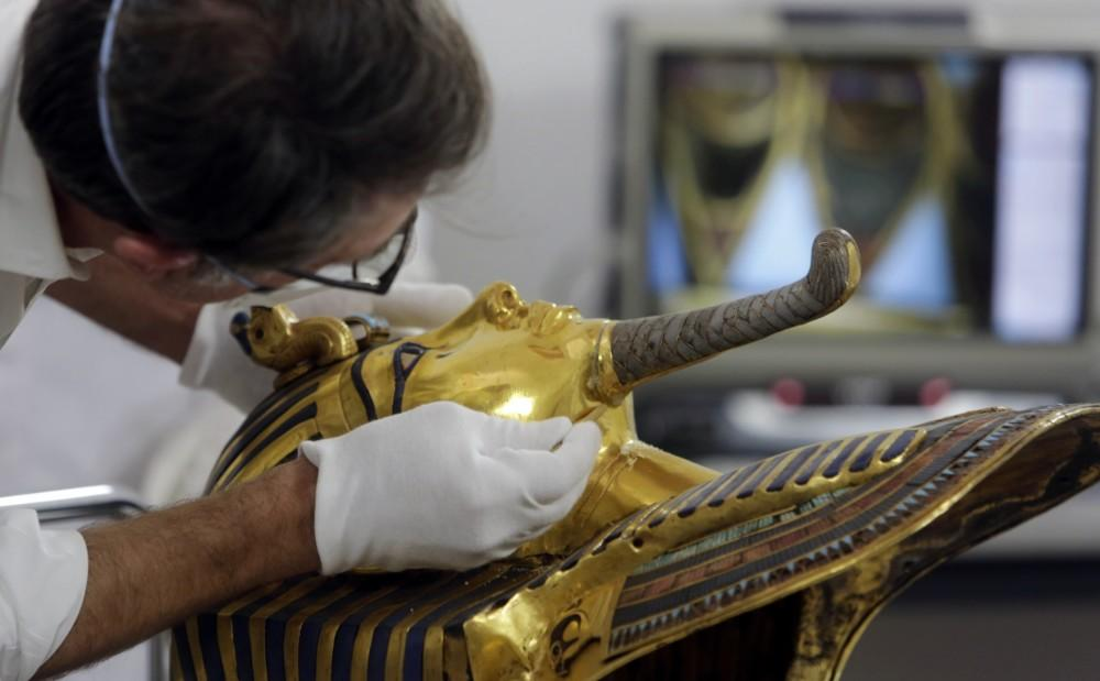 German restorer Christian Eckmann begins restoration work on the mask of King Tutankhamun.