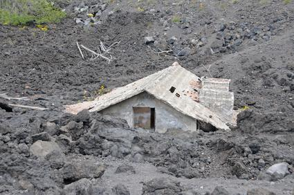 House buried under lava on the slopes of Mount Etna, Sicily, Italy