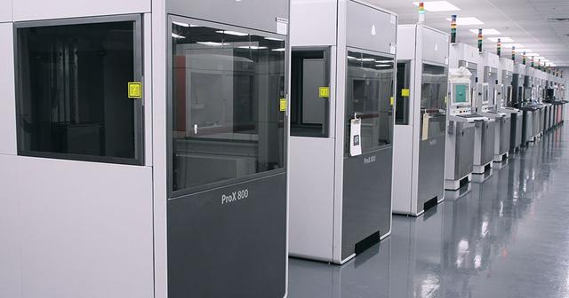 Row of 3D Systems 3D printers at one of Quickparts on-demand manufacturing sites.